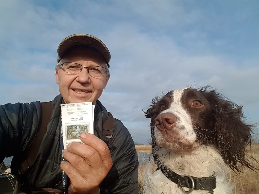 MHHC CEO, Tim Sopuck in the field with his dog and Canadian Wildlife Habitat Conservation Stamp